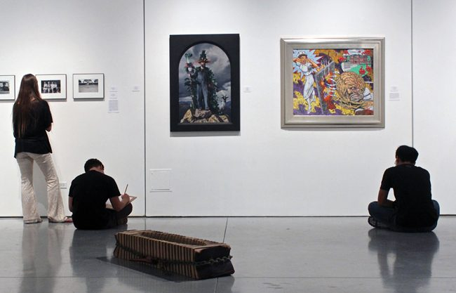 During a field trip, students who attend Northridge Academy High School take notes as they observe the artwork that decorate CSUN's Art Gallery. The exhibit