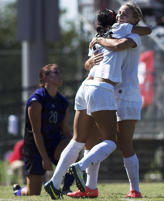 Senior Melissa Lopez (center) and junior Tabatha Dickson embrace after Lopez scores a goal for the Matadors with Dickson on the assist. The Matadors shut-out the Weber State Wildcats, 4-0, finishing their weekend at home on a high note. Photo credit: Trevor Stamp/The Sundial