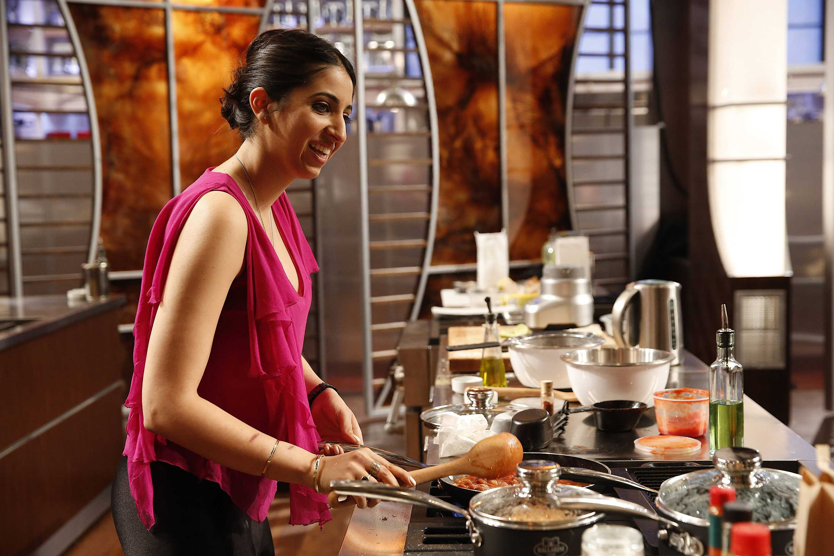 Photo Courtesy of Richard Kosters Amy Pezeshkifar, a recent CSUN graduate and culinary aficionado, prepares a dish during one of the MasterChef competitions.