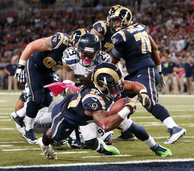 St. Louis Rams running back Tre Mason dives into the endzone past Seattle Seahawks free safety Earl Thomas (29) as he scores on a six-yard touchdown run during the first quarter on Sunday, Oct. 19, 2014, at Edward Jones Dome in St. Louis. (Courtesy of MCT)