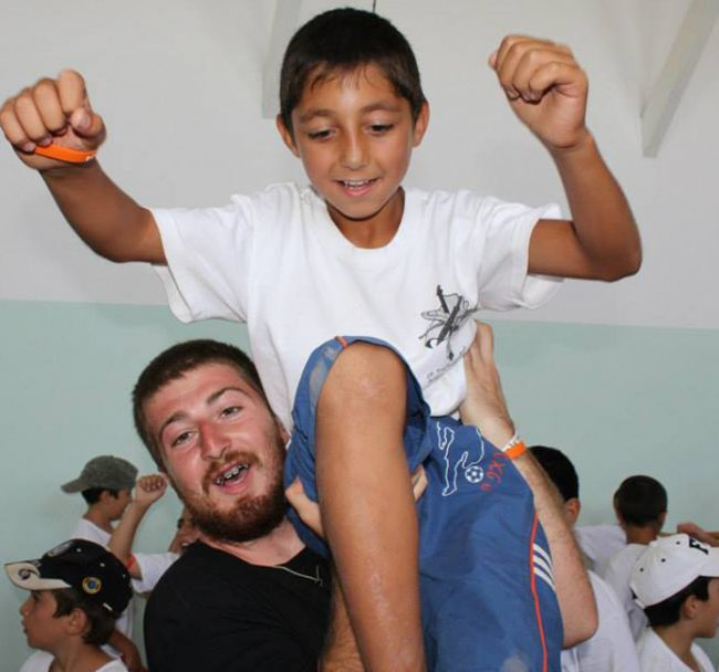 Dickran Khodanian, 21, senior, history major, volunteering this past summer at a day camp in Proshyan, Armenia, with the AYF Youth Corps program.