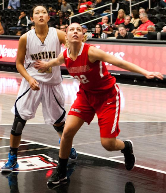 Starting forward, Randi Friess, boxes out her opponent for a defensive rebound, ending the night with a total of 4 rebounds. Photo Credit: Kelly Rosales/ Contributor