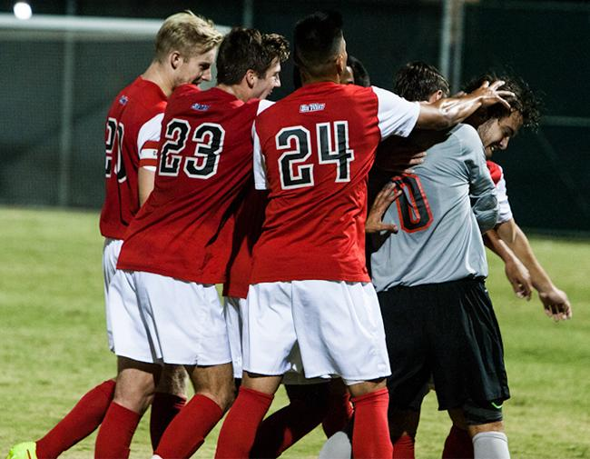 Matadors celebrate the first goal of the game by Marino Peixoto giving them a 1-0 lead in the first half. The CSUN Matadors finished the game with a 2-1 victory against the Riverside Highlanders. Photo Credit: Kelly Rosales/ Contributor