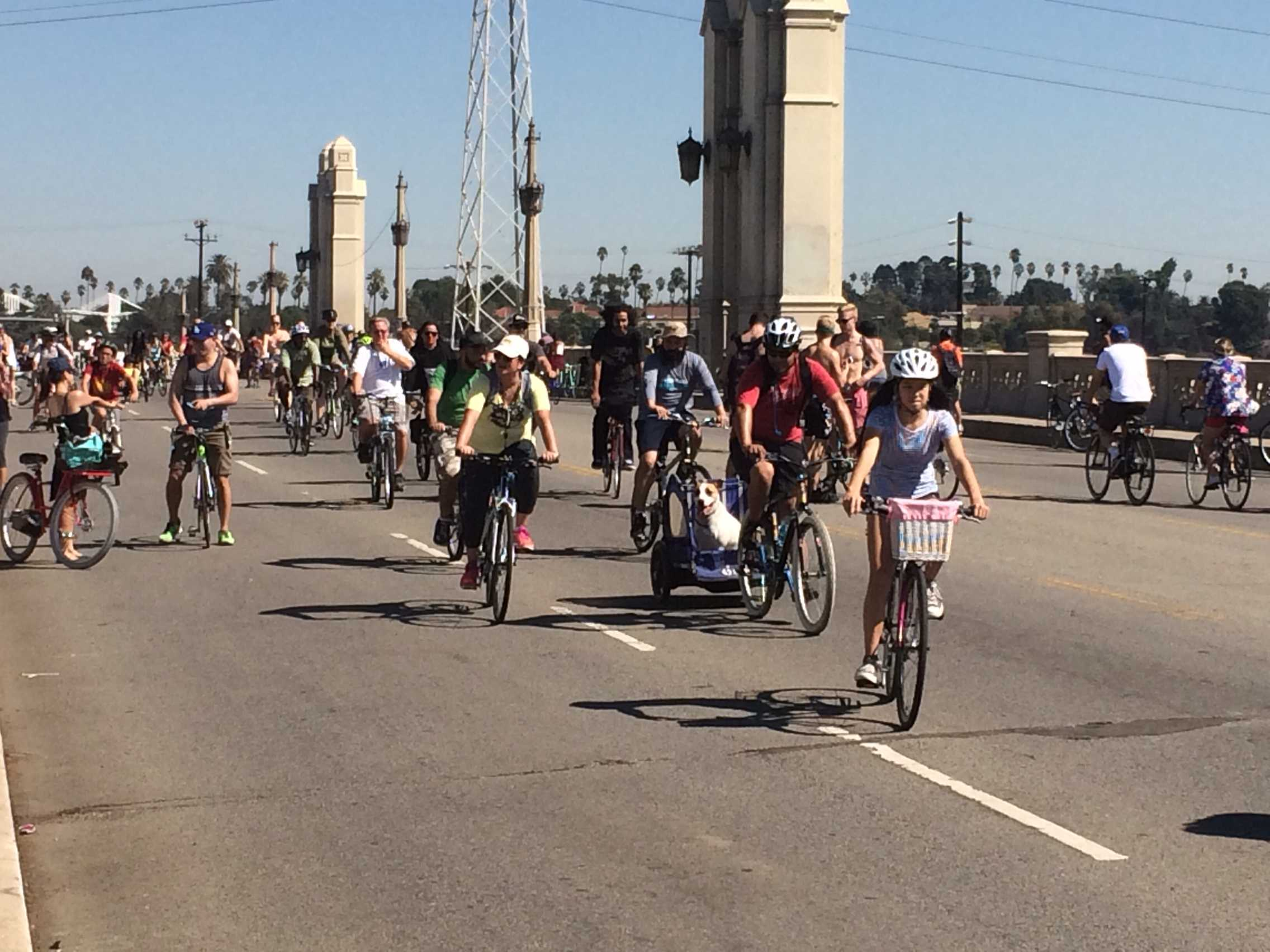 CicLAvia human and canine riders cross 4th Street bridge heading back into downtown L.A. Priscilla Ross/The Sundial.