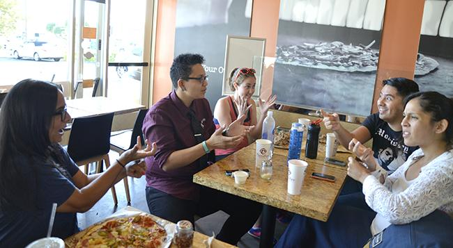 From left to right: Senior deaf studies majors Jaspreet Ghotra, president of the Deaf Students Association, Michelle Jones, 24, treasurer of the DSA, Emily Tierman, 22, Juan Ramos, 24, and Valerie Avila, 23, communicate in sign language during a fundraiser for the DSA on Tuesday, Sept. 30. at PizzaRev in Northridge, Calif. Photo Credit: Alex Vejar/ The Sundial