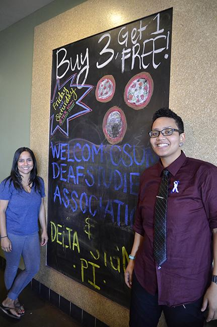 Senior deaf studies majors Jaspreet Ghotra (left), president of the Deaf Students Association, and Michelle Jones, 24, treasurer of the DSA. The DSA held a fundraiser on Tuesday, Sept. 30 at PizzaRev in Nothridge, Calif. Photo Credit: Alex Vejar/ The Sundial