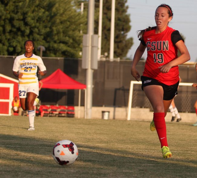 UC Riverside Highlander defender Brianna Thomasson, comes up short at minute 31  against CSUN Matador midfielder Hannah Wissler during the Sunday, October 12, 2014 1-0 victory for the Matadors. Photo Credit: Richard Kontas/ Contributor