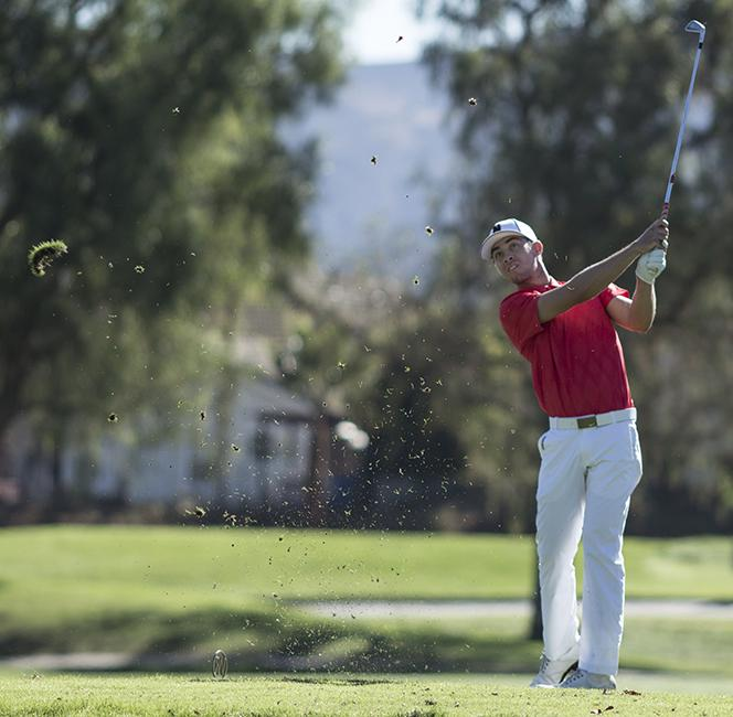 Senior Aden Louz teeing off during the Bill Cullum Invitation at Wood Ranch Golf Club in I Simi Valley on Oct. 21, 2014. Photo Credit: Trevor Stamp/ Senior Photographer