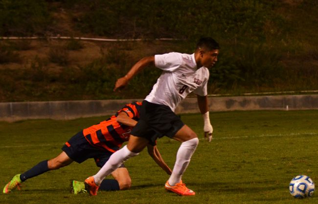 Senior forward, Edwin Rivas, leaves a Cal State Fullerton defender on the floor before crossing the ball into the box for a header. The chance was cleared as the Matadors lost to the Titans 1-0. Photo Credit: Vince Nguyen/Photo Editor