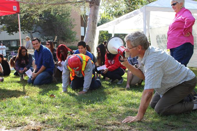 Geology professor Doug Yule announces to participating students to duck and cover during the practice drill at CSUN Shake Out, Thursday morning, Oct. 16. Yule and the students performed the drill for 15 seconds. Photo Credit: Araceli Castillo/Photo Editor