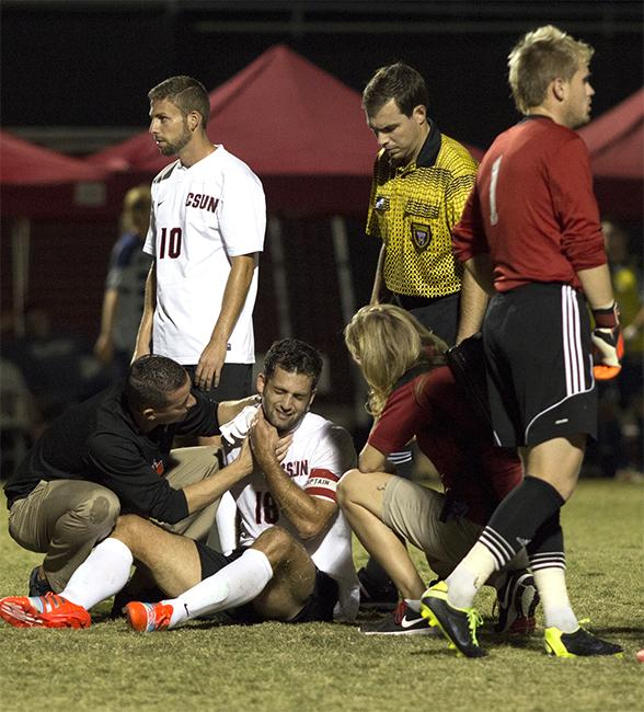 Senior Sagi Lev-Ari holds his neck after getting elbowed by UC Davis' Ramon Martin del Campo, who received a red card for the foul during Saturday night's game. The Matadors later went a man down after Redshirt sophomore Shane Steffes received a red card. Photo credit: Trevor Stamp/ Senior Photographer