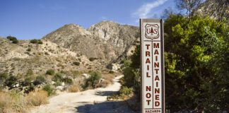 Condor Peak Trail in the Angeles National Forest is where Armando Villa hiked with the Zeta Mu chapter of Pi Kappa Phi. Signs warn hikers of hazards that the trail may have.