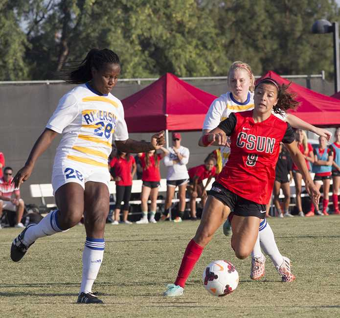 Sophomore Cynthia Sanchez races against UC Riverside's Christina Tucker for control of the ball during the Matadors' match on Oct. 12, 2014. Sanchez scored the only goal of the game, giving the Matadors the win, and a 3-0-0 record in the Big West Conference. Photo credit: Trevor Stamp/ The Sundial