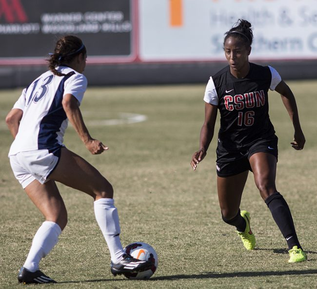 Senior Leandra Walker (right) gets into position to stop UC Davis' Sienna Drizin from breaking into a run during the Matadors' game on Oct. 16, 2014. The Matadors continued their Big Conference win streak with a 4-0 victory over the Aggies. Photo Credit: Trevor Stamp/ Senior Photographer