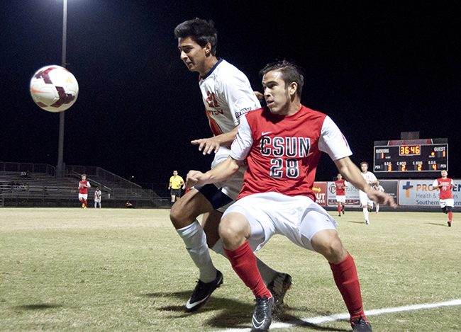 Matadors David Turcios, right, fights for the ball on the boundary line against Titans Jesse Vega, left, at the Matador Soccer Stadium on Wednesday, Nov. 5, in Northridge, Calif. The tie game prevented the Matadors from advancing to the playoffs that holds the Big West Tournament. Photo Credit: David J. Hawkins/ The Sundial