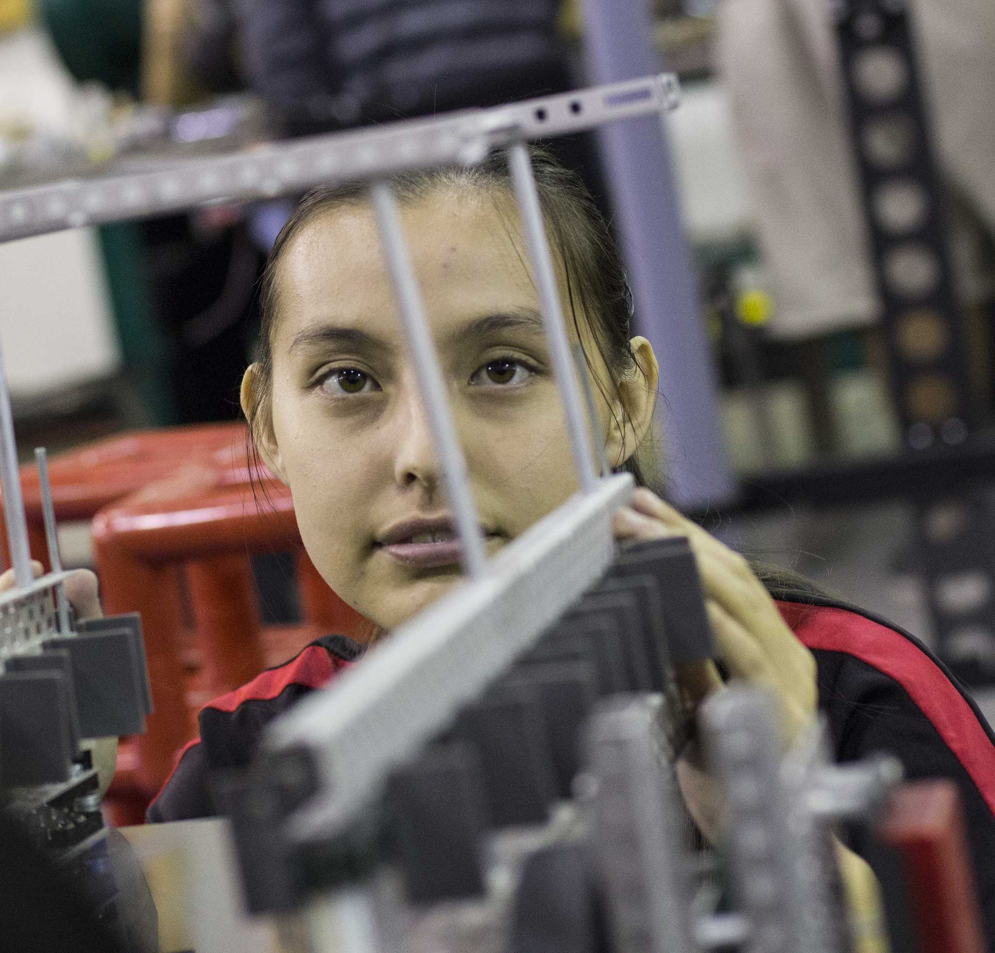 Erin Kubo, 19, freshman mechnical engineering major is one of the drivers of the robots in VEX Skyrise competitions for the Matabots. Photo credit: Trevor Stamp