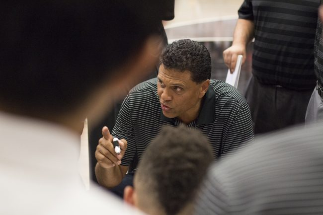 Entering his second year as head coach, Reggie Theus' experience as a NBA player and coach make him the ideal source for men's basketball players, on and off the court. Photo credit: Trevor Stamp/Senior Photographer