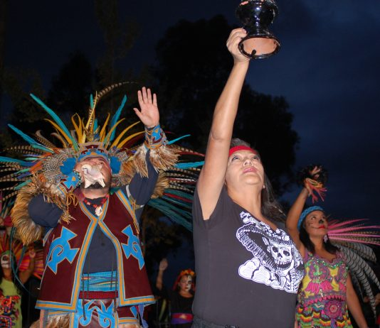 Danza Azteca de Cuauhtemoc dancers perform an indigenous ritual at the start of M.E.Ch.A.'s annual Dia de los Muertos event on Oct. 31 at the Chicano/a House.