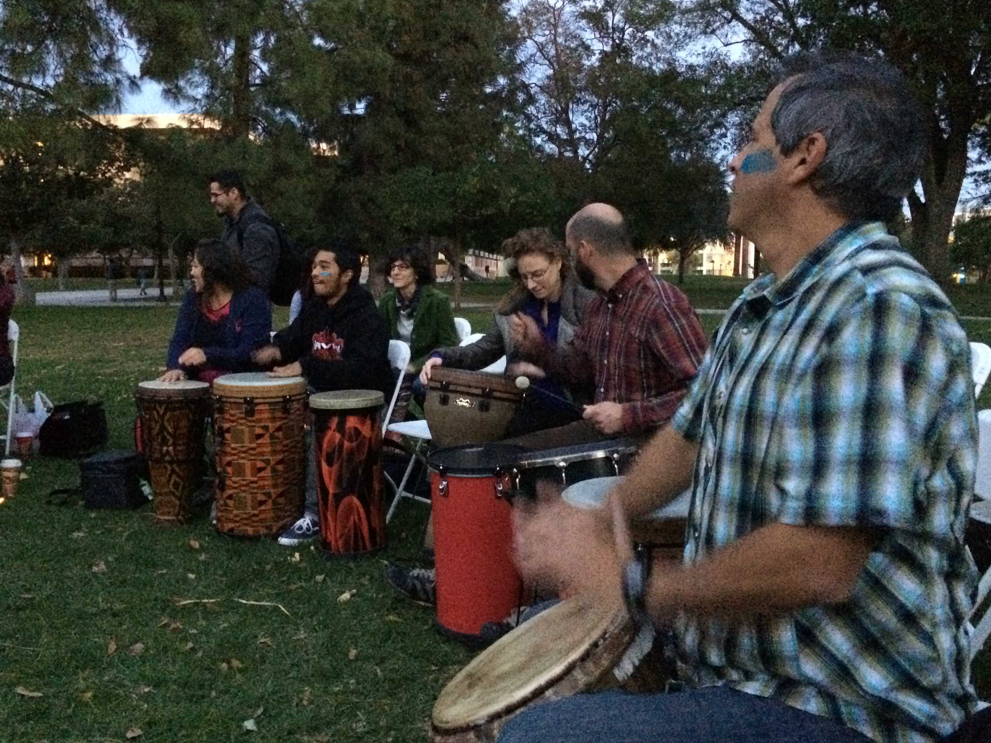 Students participate in a drum circle on the Bayramian Hall Lawn at CSUN on Monday, Nov. 17, 2014. Photo credit: Melissa Fumbark/The Sundial.