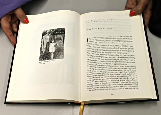 "In ""How We Survived"", 52 Holocaust children survivors tell their stories. Natalie Gold displays her chapter. The photograph is of Gold and her father after being reunited. Gold spent the course of the war in convents from the age of 18 months to 5-years-old, when her father finally found her after a 6 month search. Photo Credit: Leilani Keeping/ Contributor"