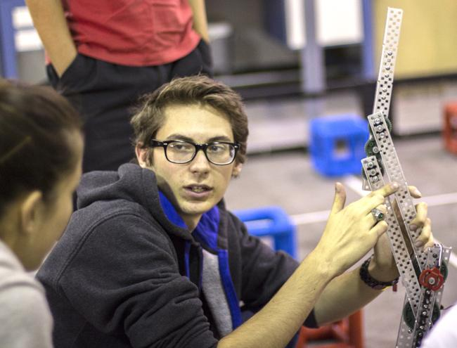 Matabots president, Nicholas Monson, discusses design issues and ideas for one of the club's robots to other members. Photo Credit: Trevor Stamp/ Senior Photographer