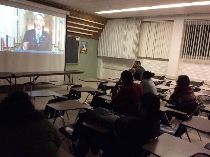 CSUN students gather in a Sierra Hall classroom to listen to President Barack Obama outline his policy for immigration reform in the United States.