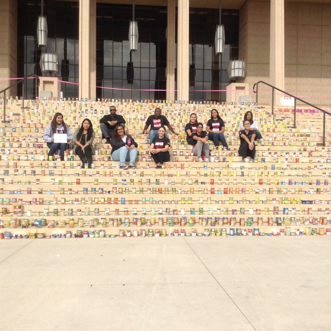 Students from the Unified We Serve student volunteer program at California State University, Northridge, are shown with donations in front of the Oviatt Library on Thursday, Nov. 13, 2014.