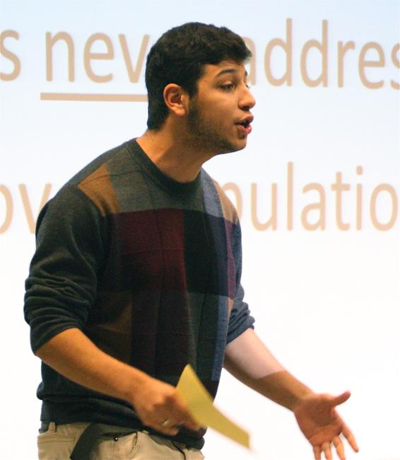 Hector (played by Laith Helo) gets emotional as he presents a Powerpoint presentation to the lecture hall about over population. The Postmortal Performance Project was presented by the University 100 class on Nov. 14. Photo Credit: Richard Kontas/Contributor