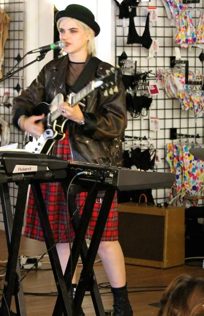 """Soko performing """"Dreams Dictate My Reality,"""" the title track off her upcoming record to a young, eclectic audience at American Apparel on Melrose. Photo: Demi Corso/The Sundial"""