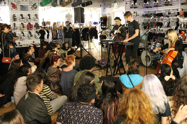 """Soko performing to an intimate, young, eclectic audience at American Apparel on Melrose. """"I feel like they only sent the invite to really hot people tonight, like they had a casting for my audience,"""" said Soko. Photo Credit: Demi Corso/The Sundial"""