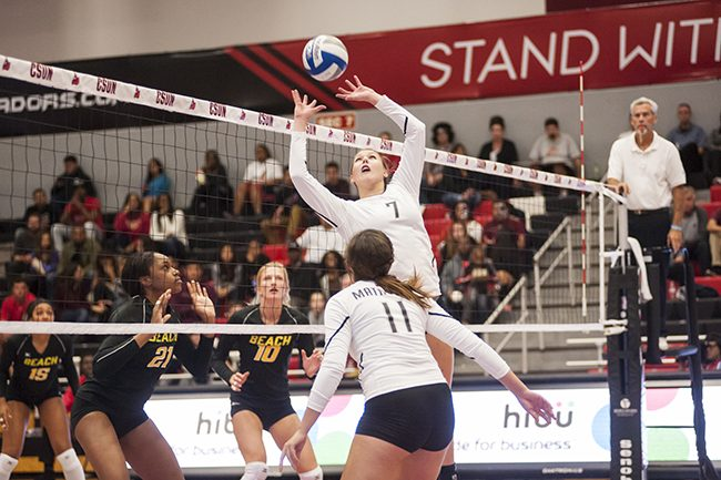 Matadors Lauren Conati, center top, sets the ball for Rachel Diaz, bottom, against Long Beach State on Saturday, November 1, 2014 at the Matadome in Northridge, Calif. Photo Credit: David J. Hawkins/ The Sundial