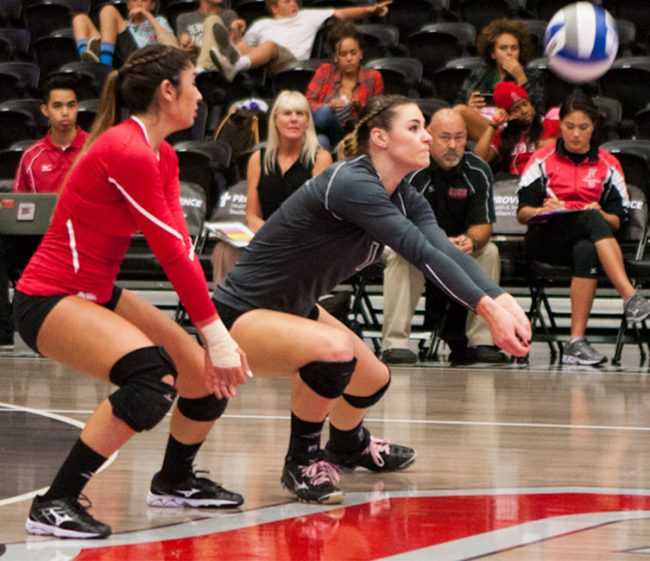 Casey Hinger calls off libero Kelcie Randazzo, digging up a tough ball against Cal Poly Nov. 15. Photo Credit: Kelly Rosales/ Contributor