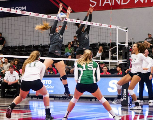 Middle Blocker, Sam Kaul blocking alongside Danetta Boykin. Kaul ended the night with 5 blocks. Photo Credit: Kelly Rosales/Contributor