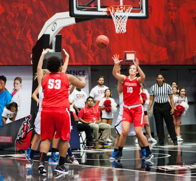 Junior center Bernadette Fong passes to senior center Camille Mahlknecht during an exhibition against Master's College. CSUN blew out the Mustang's 90-56 on OCt. 31. Photo Credit: Kelly Rosales/Contributor