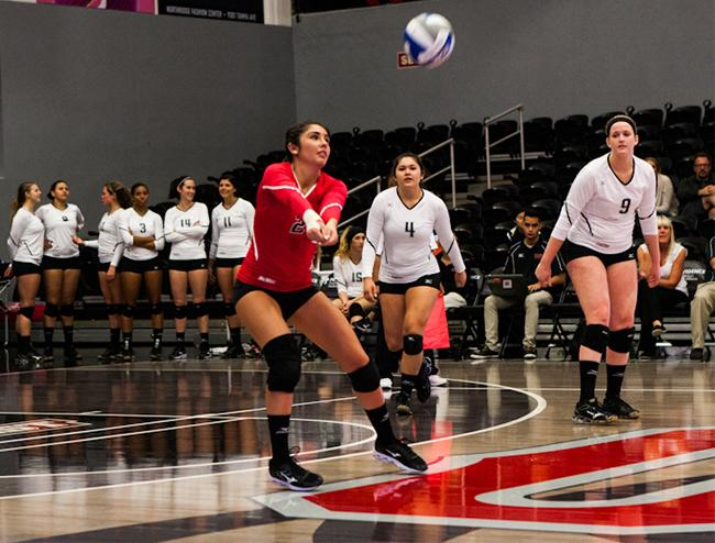 Senior, libero, Kelcie Randazzo, hits the ball and the Matadors sweep the Titans 3-0, in tonights game. Photo Credit: Kelly Rosales/Contributor
