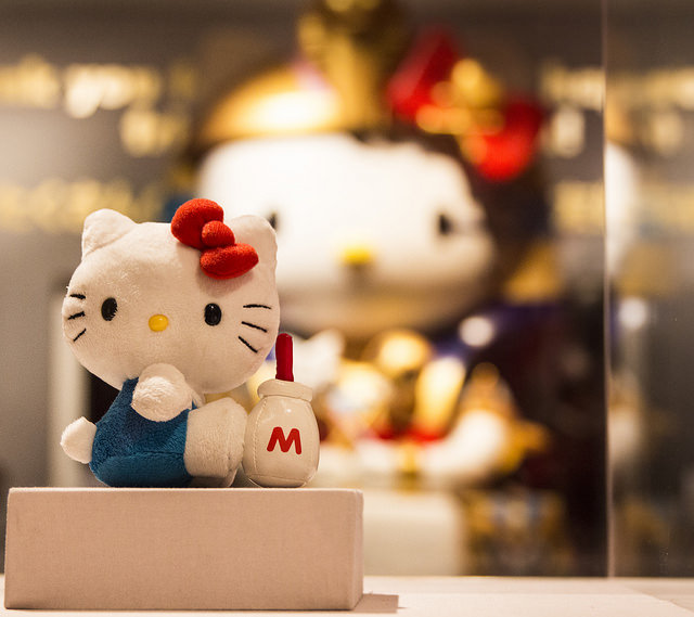 Little Kitty, Big Kitty: A giant statue of Hello Kitty overshadows a tiny plush version on display at the Hello! Exploring the Supercute World of Hello Kitty exhibit at the Japanese American National Museum located in Little Tokyo. The exhibit runs until April 26, 2015. Photo credit: Trevor Stamp