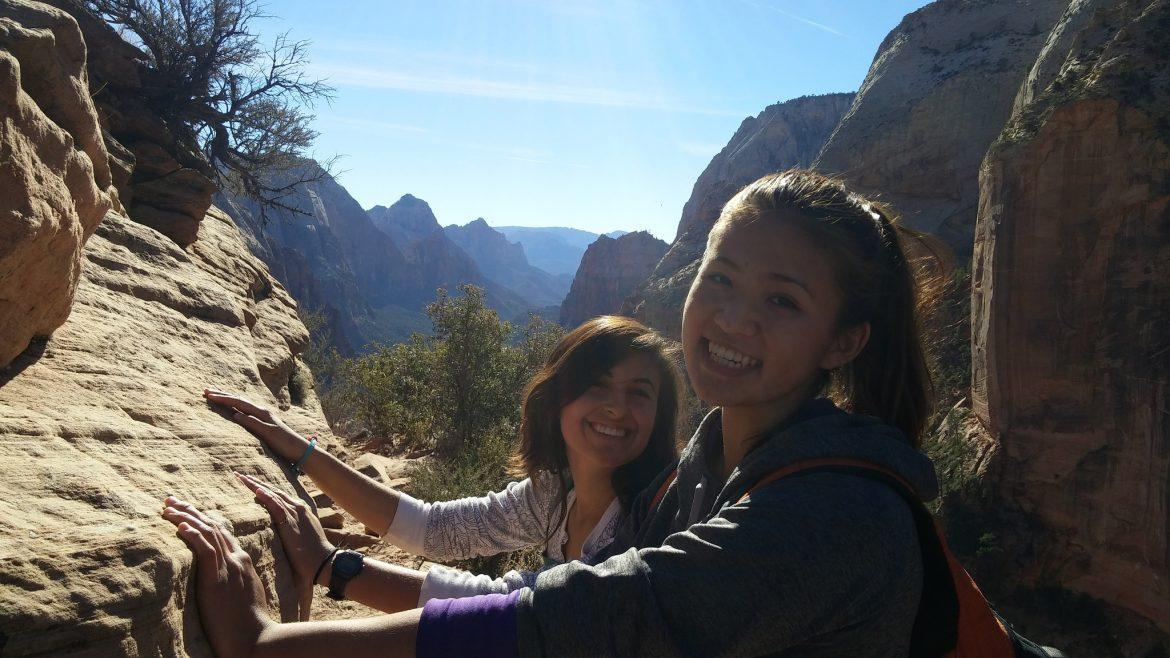 Outdoor Adventure guide Ariana Cortes, left, and participant Auriana Petach, right, take in the beautiful view from Angels Landing in Zion National Park, Utah. Photo Credit: Samantha Petersen / Sundial Staff