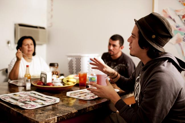 Daniel pays a visit to his mom, Maria Hurtado and step-dad Enrique Ventura, just before heading out to a friends house. They talk about the upcoming art show and the Los Angeles Dodgers. Photo Credit: Joshua Bantay/Contributor