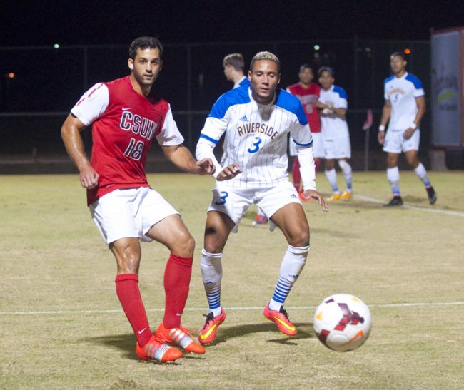 Matadors Sagi Lev-Ari, left, and Otis Earle, right, battles for the ball during the first half on Saturday, Oct. 18, 2014 at the Matador Soccer Field in Northridge, Calif. The Matadors defeat the UC Riverside Highlanders with a score of 2-1 advancing them to third place in the Big West South Division. Photo Credit: David J. Hawkins/The Sundial