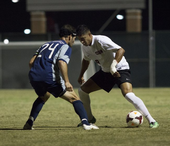 Redshirt senior Edwin Rivasgoes head-to-head with UC Davis' Brian Ford in Saturday night's matchup. After a tense matach that bled into overtime, the Matadors iied the Aggies 0-0. Photo credit: Trevor Stamp