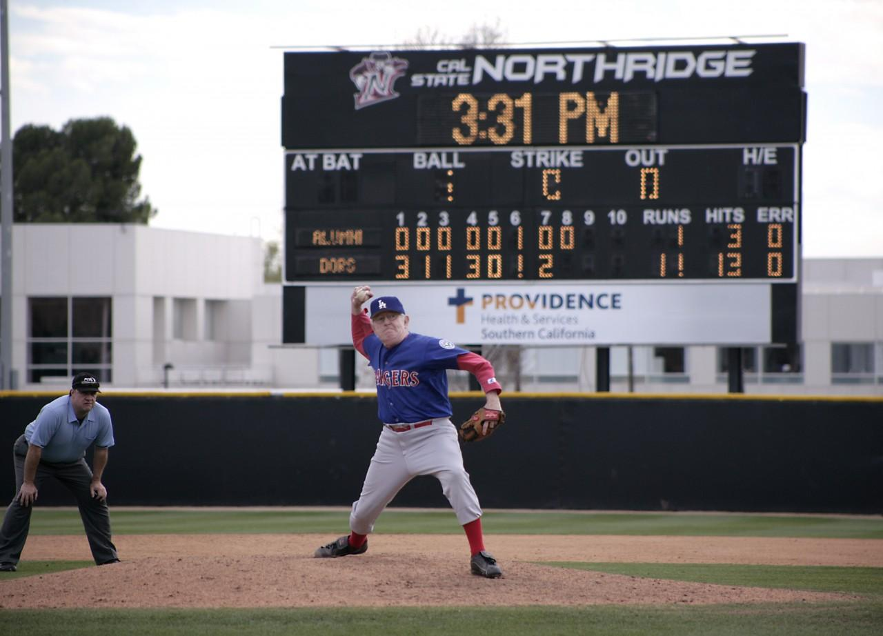 "James ""Jim"" Mosely, age 72,  takes the mound and throws a strong 8th-innning in the alumni game at the Matador Field in Northridge, Calif., on Sunday January 25, 2015. Photo credit: Raul Martinez"