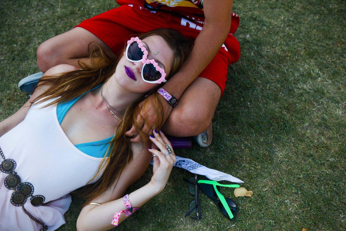 Chloe Rudningen rests in the shade between shows on the second day of the Coachella Music and Arts Festival in Indio, Calif., on Saturday, April 12, 2014.