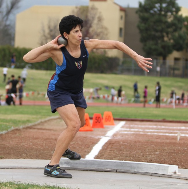 Linda Cohn, 62, a National Masters Champion competes in the shot put at the All Comers meet on Feb. 7, 2015.