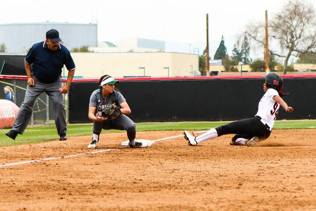Sophomore Taylor Glover safely stealing 3rd base against Sacramento Hornets February 27th, 2015. Photo credit: Kelly Rosales