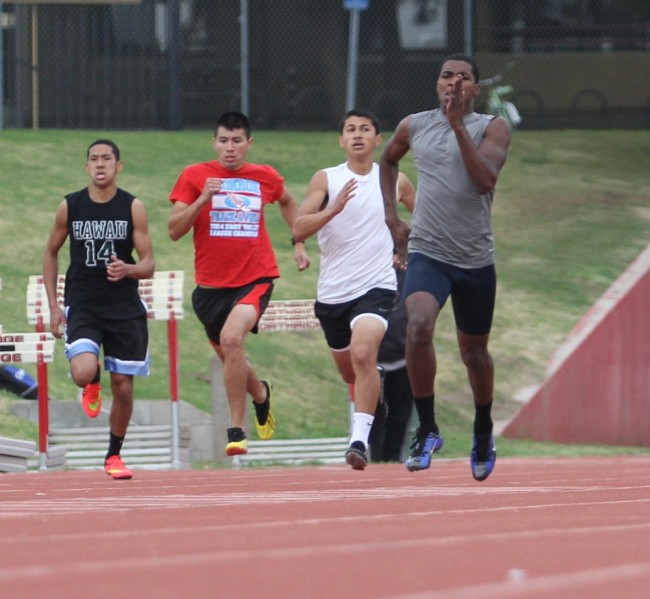 Arshaad Rahh, 21, a CSUN Junior (far right, grey shirt) winning the 400 meter at the All Comers meet on Feb. 7, 2015.
