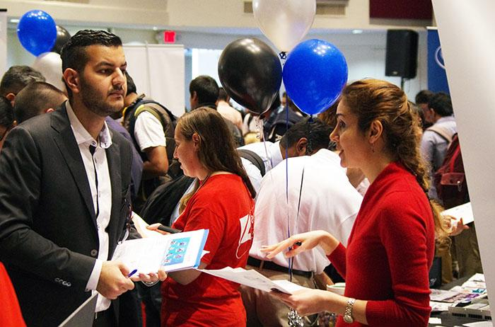With+over+thirty+different+companies+in+attendence%2C+students+network+and+mingle+at+Techfest+at+the+Northridge+Center+on+Feb.+25th%2C+2015+%28Matthew+Delgado+%2F+Staff+Photographer%29