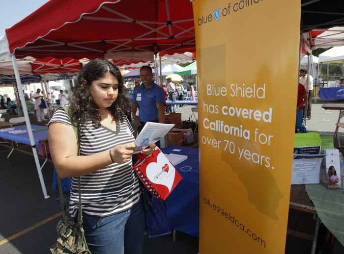 Sophia Bracho gets enrollment information from Blue Shield of California last fall in Los Angeles. The insurer faces questions about its 2015 networks. (Gary Friedman/Los Angeles Times/TNS)
