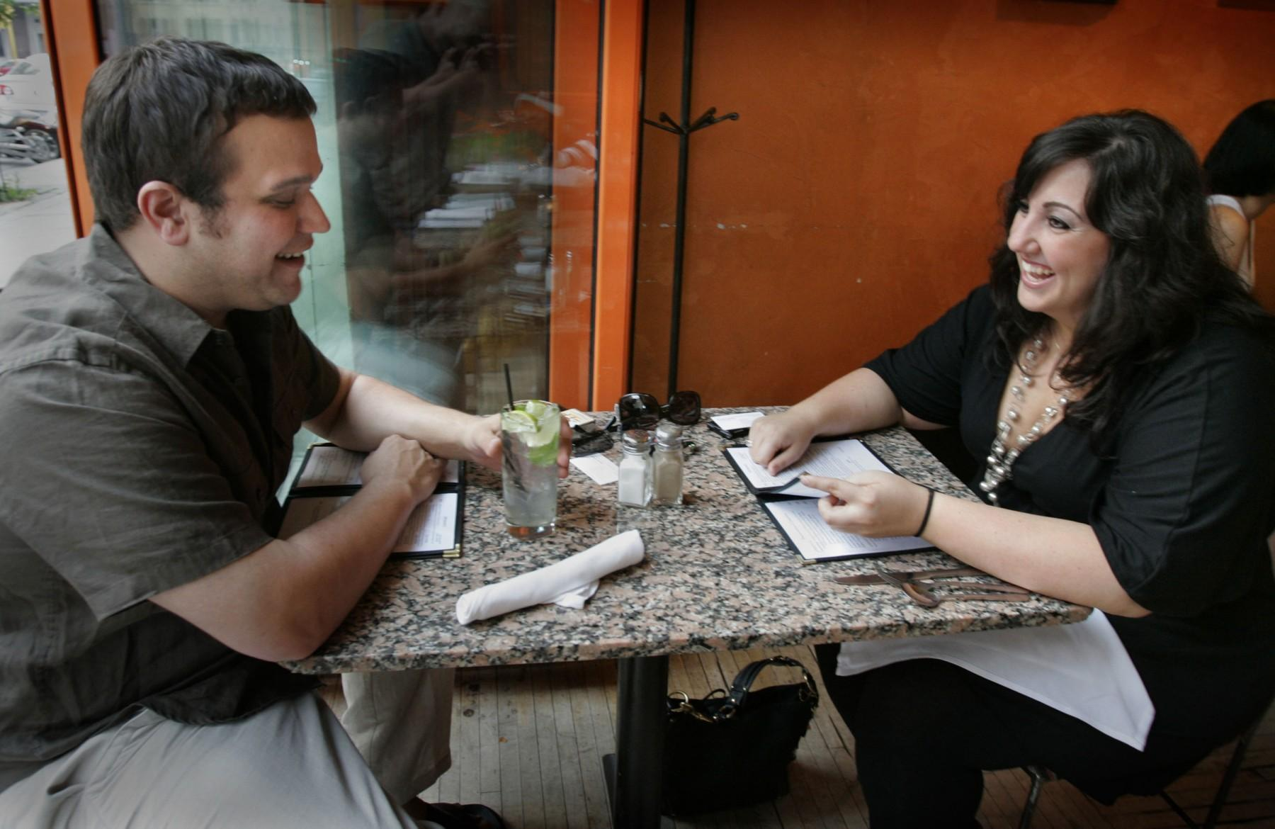Victor Champeau and Gina Pipito enjoy a nice warm evening at an open air table on a Wednesday night date. They are part of a changing dating scene where singles save weekends for buddies and bar-hopping and shift budding romance to weekday lunches and weeknight encounters. (Gary Porter/Milwaukee Journal Sentinel/MCT)