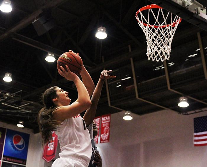 Freshman Tessa Boagni doesn't let a hand her face stop her from going up for a shot against UC Irvine during the first half of the Matadors' game on Feb. 21, 2015. (Trevor Stamp / Multimedia Editor)