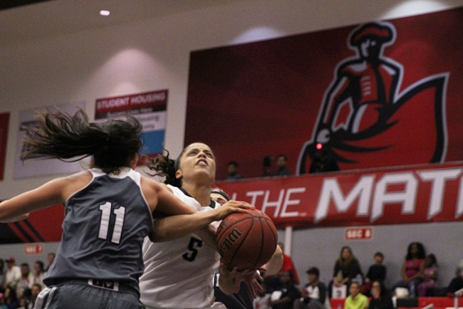 Senior Ashlee Guay gets fouled on her way to the hoop during the second half of the Matadors' game against UC Irvine on Feb. 21, 2015. Guay led the way with 18 points. (Trevor Stamp / Multimedia Editor)